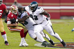 San Francisco 49ers quarterback Nick Mullens (4) is sacked by Philadelphia Eagles defensive end Genard Avery, center, during the first half of an NFL football game in Santa Clara, Calif., Sunday, Oct. 4, 2020. At right is nose tackle Javon Hargrave (93). (AP Photo/Tony Avelar)