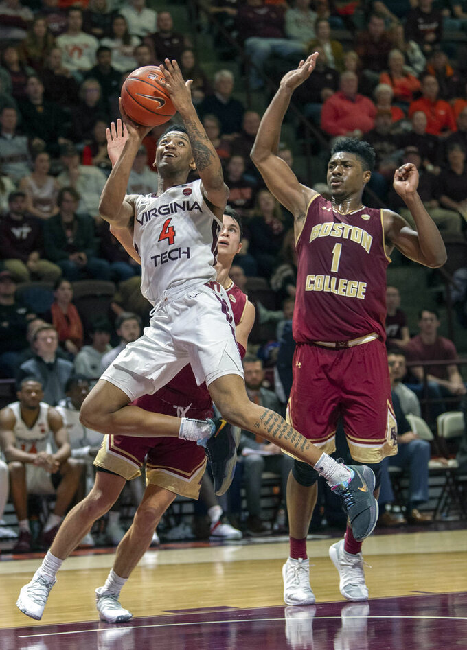 Virginia Tech guard Nickeil Alexander-Walker (4) goes up for a basket against Boston College guard Chris Herren Jr. (4) and forward Jairus Hamilton (1) during the second half of an NCAA college basketball game Saturday, Jan. 5, 2019, in Blacksburg, Va. Tech won 77-66. (AP Photo/Don Petersen)
