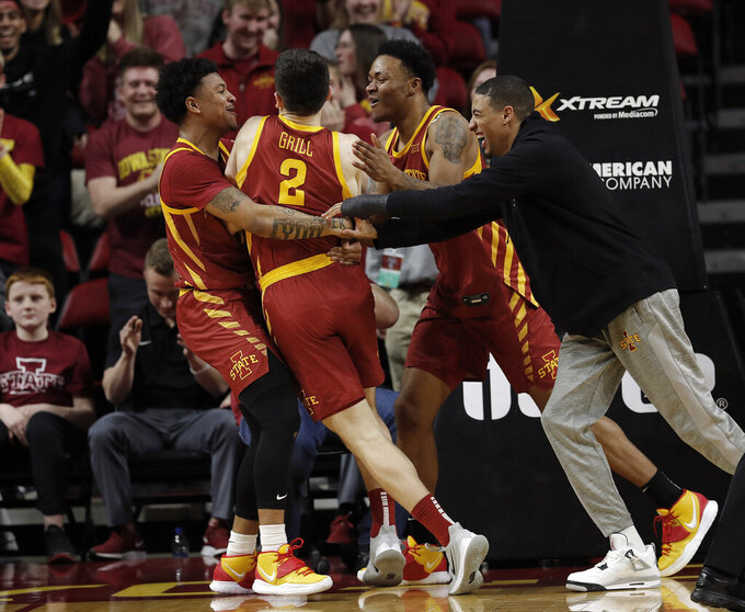 Iowa State's Prentiss Nixon, left, Caleb Grill, center left, GrillZion Griffin, center right, and Tyrese Haliburton, right, celebrate their 65-59 win over TCU in a second half of an NCAA college basketball game, Tuesday, Feb. 25, 2020, in Ames, Iowa. (AP Photo/Matthew Putney)