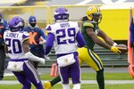 Green Bay Packers' Davante Adams catckes a touchdown pass during the first half of an NFL football game against the Minnesota Vikings Sunday, Nov. 1, 2020, in Green Bay, Wis. (AP Photo/Mike Roemer)