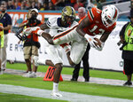 Miami running back DeeJay Dallas (13) stretches for a first down at the 4-yard-line in front of Pittsburgh defensive back Jazzee Stocker, left, during the second half of an NCAA college football game, Saturday, Nov. 24, 2018, in Miami Gardens, Fla. Miami won 24-3. (AP Photo/Lynne Sladky)