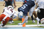 North Carolina's Dazz Newsome (5) hurdles into the end zone for a touchdown in the second quarter against Virginia Tech 's Devin Taylor (24) during an NCAA college football game, Saturday, Oct. 10, 2020 at Kenan Stadium in Chapel Hill, N.C. (Robert Willett/The News & Observer via AP)