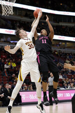 Minnesota's Matz Stockman (35) blocks a shot by Penn State's Lamar Stevens (11) during the first half of an NCAA college basketball game in the second round of the Big Ten Conference tournament, Thursday, March 14, 2019, in Chicago. (AP Photo/Nam Y. Huh)