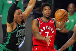 Toronto Raptors' Kyle Lowry (7) drives to th basket as Boston Celtics' Grant Williams (12) closes in during the first half of an NBA conference semifinal playoff basketball game Monday, Sept. 7, 2020, in Lake Buena Vista, Fla. (AP Photo/Mark J. Terrill)
