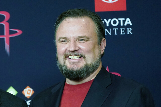 FILE - This is a July 26, 2019, file photo showing Houston Rockets General Manager Daryl Morey during an NBA basketball news conference in Houston. The Philadelphia 76ers are in advanced negotiations with Morey to become president of basketball operations as part of the overhaul of the front office that began after an underachieving season. The deal is expected to be finalized as early as this weekend, multiple people with direct knowledge of the negotiations told The Associated Press on condition of anonymity because it has not been made official. Morey and the Rockets split a little over a year after he sparked a rift between the NBA and Chinese government. (AP Photo/David J. Phillip, File)