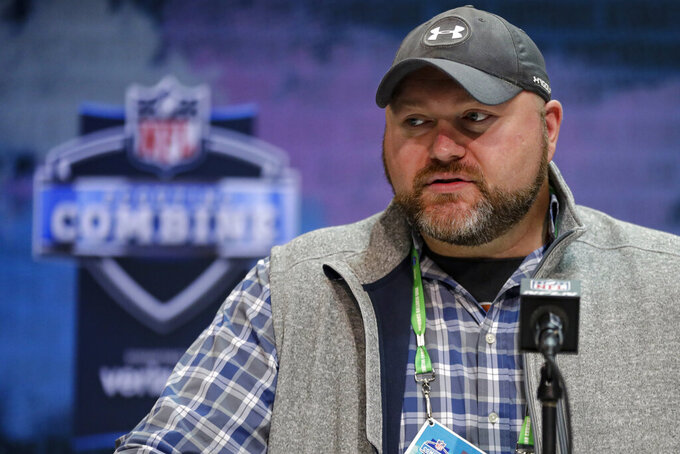 FILE - New York Jets general manager Joe Douglas speaks during a press conference at the NFL football scouting combine in Indianapolis, in this Tuesday, Feb. 25, 2020, file photo. The New York Jets head into the NFL draft needing a quarterback and they hope to find the face of the franchise who can develop into a star and lead them to sustained success. General manager Joe Douglas knows the spotlight will be on him and whomever he selects since it will likely be a career-defining choice for him and franchise-shaping decision for the Jets. (AP Photo/Michael Conroy, File)