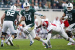 Michigan State quarterback Brian Lewerke (14) runs on a keeper against Indiana's James Head Jr. (6) during the fourth quarter of an NCAA college football game, Saturday, Sept. 28, 2019, in East Lansing, Mich. (AP Photo/Al Goldis)