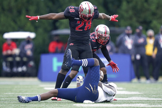 Western Kentucky defensive end Demetrius Cain (28) celebrates a play during the second half of the team's NCAA college football game against Florida International, Saturday, Nov. 21, 2020, in Bowling Green, Ky. (AP Photo/Bryan Woolston)