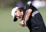 England's Tommy Fleetwood plays a shot on the 2nd hole during the second round of the DP World Tour Championship golf tournament in Dubai, United Arab Emirates, Friday, Nov. 22, 2019. (AP Photo/Kamran Jebreili)