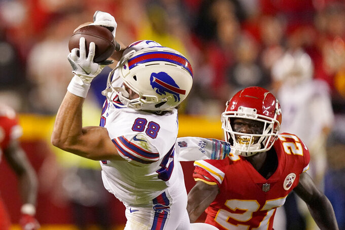Buffalo Bills tight end Dawson Knox (88) catches a pass as Kansas City Chiefs cornerback Rashad Fenton (27) defends during the second half of an NFL football game Sunday, Oct. 10, 2021, in Kansas City, Mo. (AP Photo/Charlie Riedel)