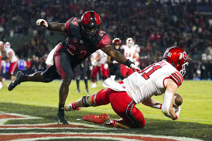 Utah wide receiver Connor O'Toole (81) tries to catch a pass in the end zone ahead of San Diego State linebacker Segun Olubi (24) during triple overtime of an NCAA college football game Saturday, Sept. 18, 2021, in Carson, Calif. The pass was ruled incomplete upon official review. San Diego State won 33-31. (AP Photo/Ashley Landis)