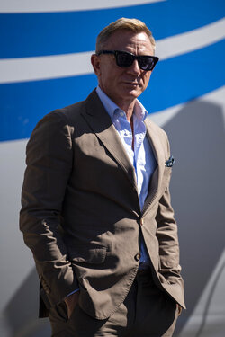 Actor and honorary starter Daniel Craig poses in Victory Lane prior to a NASCAR Cup Series auto race at Charlotte Motor Speedway, Sunday, Oct. 10, 2021, in Concord, N.C. (AP Photo/Matt Kelley)