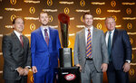 FILE - In this Dec. 6, 2018, file photo, College Football Playoff football coaches, from left, Nick Saban of Alabama; Lincoln Riley of Oklahoma; Dabo Swinney of Clemson and Brian Kelly of Notre Dame pose with the college football championship trophy after a news conference  in Atlanta. Oklahoma coach Lincoln Riley has been to the College Football Playoff twice and coached two Heisman winners since taking over as Oklahoma's coach 18 months ago. With all that success already at age 35, the school will have to battle to hold NFL teams at bay. (AP Photo/John Bazemore)