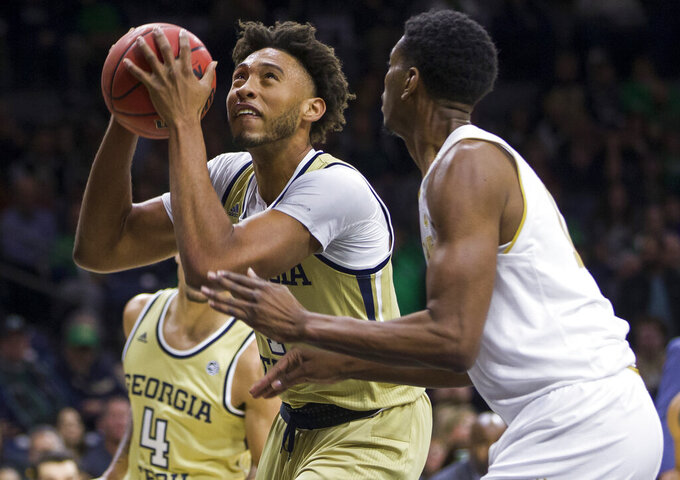 Georgia Tech's James Banks III, left, looks for a shot next to Notre Dame's Juwan Durham during the first half of an NCAA college basketball game Saturday, Feb. 1, 2020, in South Bend, Ind. (AP Photo/Robert Franklin)