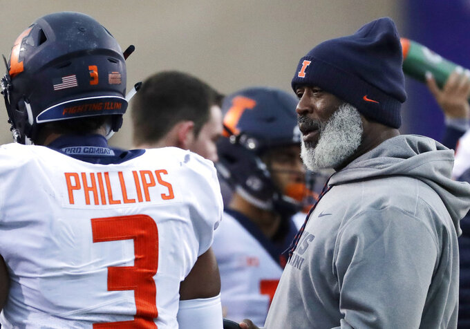 Illinois head coach Lovie Smith, right, talks to linebacker Del' Shawn Phillips during the first half of an NCAA college football game against Northwestern in Evanston, Ill., Saturday, Nov. 24, 2018. Northwestern won 24-16. (AP Photo/Nam Y. Huh)