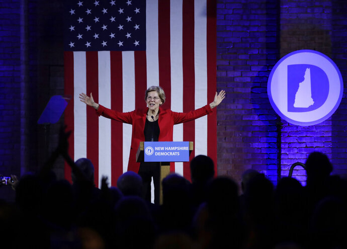 Democratic presidential candidate Sen. Elizabeth Warren, D-Mass., acknowledges applause at the New Hampshire Democratic Party's 60th Annual McIntyre-Shaheen 100 Club Dinner, Friday, Feb. 22, 2019, in Manchester, N.H. (AP Photo/Elise Amendola)
