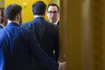 Treasury Secretary Steve Mnuchin, right, departs the Republican policy luncheon on Capitol Hill, Tuesday, Jan. 15, 2019 in Washington. (AP Photo/Alex Brandon)