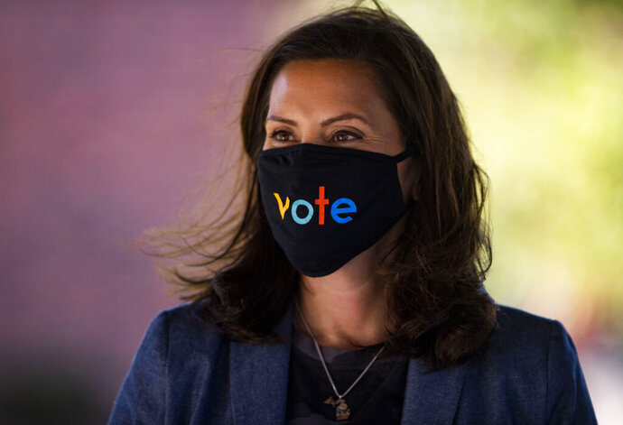 Michigan Gov. Gretchen Whitmer wears a mask with the word