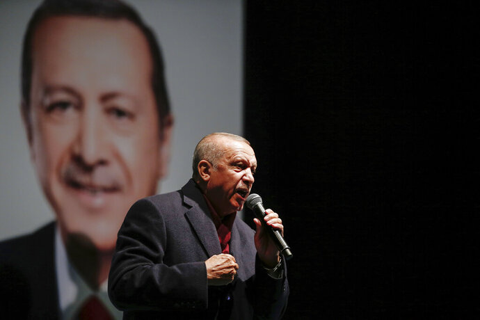 Turkey's President Recep Tayyip Erdogan addresses the supporters of his ruling Justice and Development Party, AKP, at a rally in Istanbul, late Tuesday, March 19, 2019, ahead of local elections scheduled for March 31, 2019. (AP Photo/Emrah Gurel)