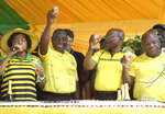 In this photo taken Tuesday, Jan. 8, 2019, former South African president Jacob Zuma, second right, and President Cyril Ramaphosa, second left, toast the party at the African National Congress' 107th birthday celebrations in Durban, South Africa. Zuma, who was forced from office last year by scandal, is now in the midst of a remarkable makeover, wooed by a ruling party that recognises his enduring appeal to some supporters and is anxious to paper over divisions ahead of elections this year. (AP Photo)