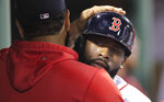Boston Red Sox's Jackie Bradley Jr., right, is congratulated by Eduardo Rodriguez after his solo home run off Philadelphia Phillies starting pitcher Drew Smyly in the second inning during a baseball game at Fenway Park in Boston, Wednesday, Aug. 21, 2019. (AP Photo/Charles Krupa)