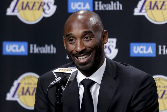 FILE - In this Dc. 18, 2017 file photo, former Los Angeles Laker Kobe Bryant talks during a news conference in Los Angeles.  Bryant and fellow NBA greats Tim Duncan and Kevin Garnett headlined a nine-person group announced Saturday, April 4, 2020,  as this year's class of enshrinees into the Naismith Memorial Basketball Hall of Fame. They all got into the Hall in their first year of eligibility, as did WNBA great Tamika Catchings. Two-time NBA champion coach Rudy Tomjanovich, longtime Baylor women's coach Kim Mulkey, 1,000-game winner Barbara Stevens of Bentley and three-time Final Four coach Eddie Sutton were selected. So was former FIBA Secretary General Patrick Baumann. (AP Photo/Chris Carlson, File)