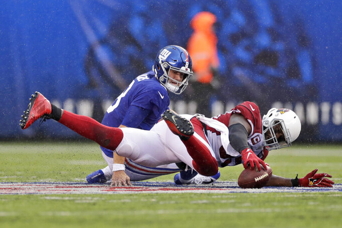 Arizona Cardinals' Chandler Jones, right, recovers a fumble by New York Giants quarterback Daniel Jones during the second half of an NFL football game, Sunday, Oct. 20, 2019, in East Rutherford, N.J. (AP Photo/Adam Hunger)