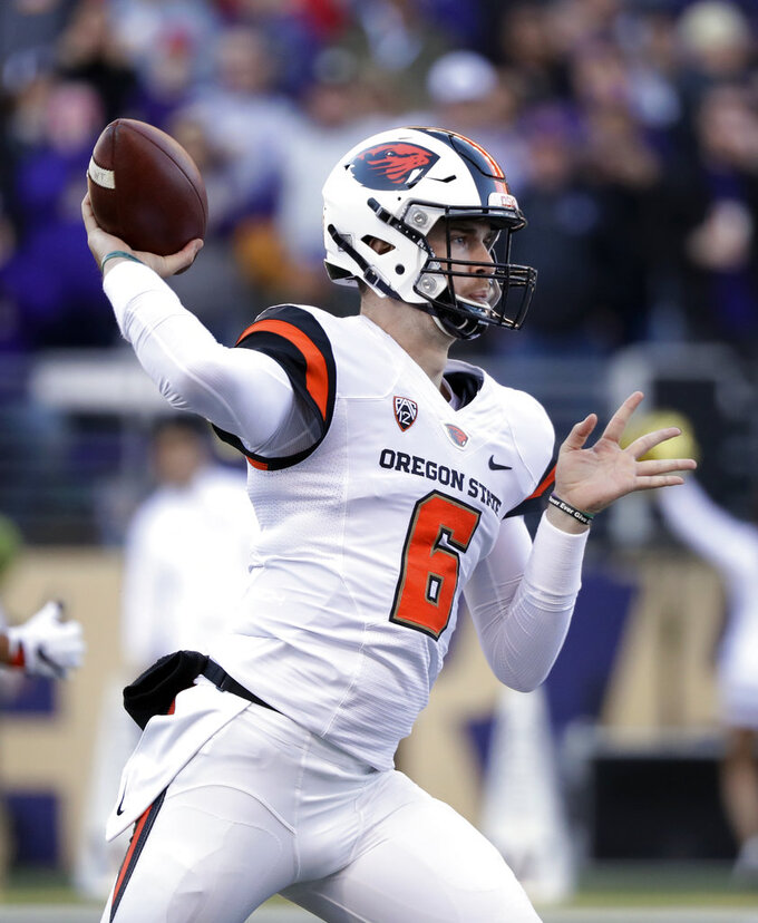 Oregon State quarterback Jake Luton passes against Washington in the first half of an NCAA college football game Saturday, Nov. 17, 2018, in Seattle. (AP Photo/Elaine Thompson)