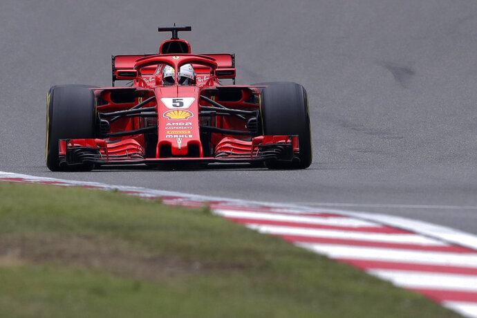 Ferrari driver Sebastian Vettel of Germany steers his car during the qualifying session for the Chinese Formula One Grand Prix at the Shanghai International Circuit in Shanghai, Saturday, April 14, 2018. Vettel took pole position for Sunday's race. (AP Photo/Andy Wong)