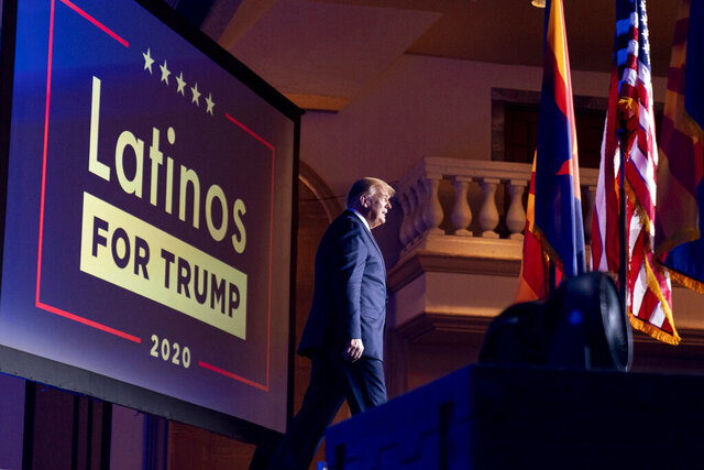 FILE - In this Sept. 14, 2020 file photo, President Donald Trump arrives for a Latinos for Trump Coalition roundtable at Arizona Grand Resort & Spa in Phoenix. President Donald Trump is putting up a fight for Latino voters in key swing states with Democratic candidate Joe Biden. Polls show Biden with a commanding overall lead with Hispanic voters, a diverse group that defies neat political categories. Still, about 3 in 10 registered Latino voters nationwide back Trump, roughly consistent with how Latinos voted in 2018 congressional elections and in 2016. Latino men, like men of other races, support Trump more than Hispanic women. (AP Photo/Andrew Harnik, File)