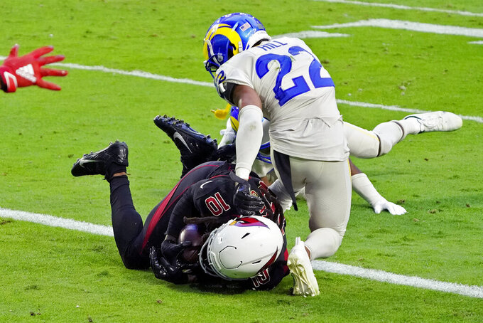 Arizona Cardinals wide receiver DeAndre Hopkins (10) scores a touchdown as Los Angeles Rams cornerback Troy Hill (22) defends during the second half of an NFL football game, Sunday, Dec. 6, 2020, in Glendale, Ariz. (AP Photo/Rick Scuteri)