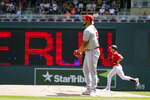 Los Angeles Angels pitcher Jaime Barria, center, gives up a solo home run to Minnesota Twins' Max Kepler, right, in the first inning of a baseball game, Sunday, July 25, 2021, in Minneapolis. (AP Photo/Jim Mone)