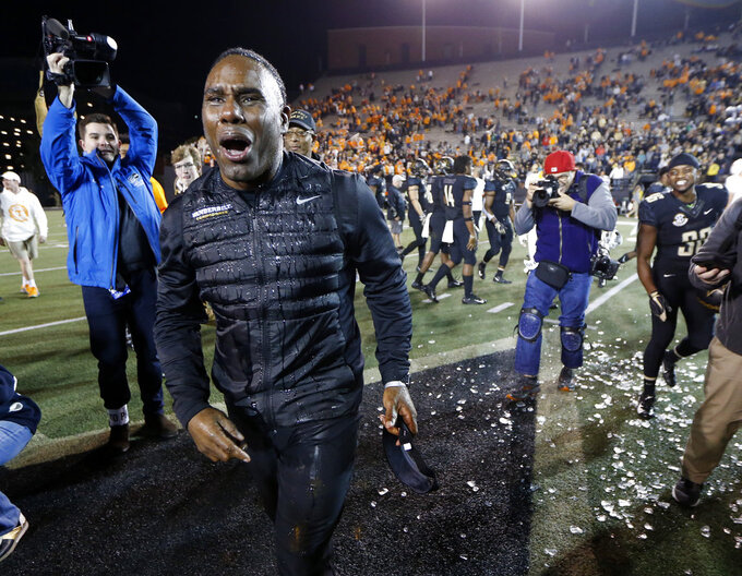 Vanderbilt head coach Derek Mason reacts after being doused after his team defeated Tennessee in an NCAA college football game Saturday, Nov. 24, 2018, in Nashville, Tenn. (AP Photo/Mark Humphrey)