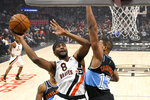 Los Angeles Clippers forward Maurice Harkless, left, shoots as Cleveland Cavaliers center Tristan Thompson defends during the first half of an NBA basketball game Tuesday, Jan. 14, 2020, in Los Angeles. (AP Photo/Mark J. Terrill)