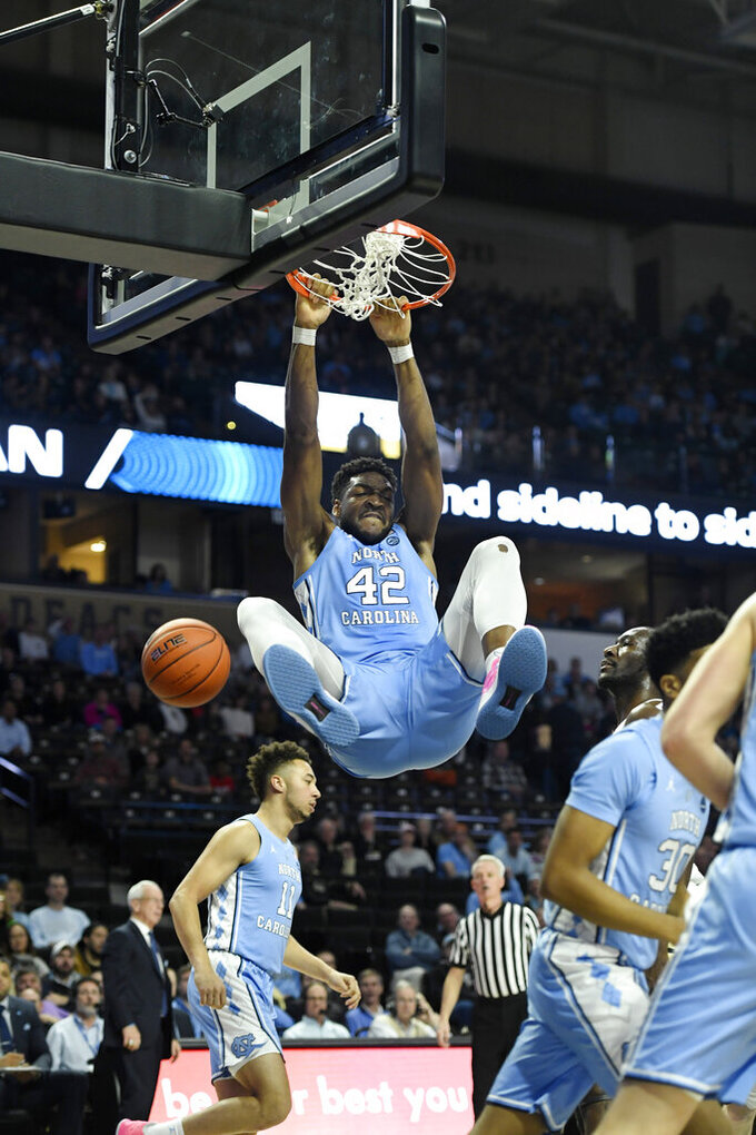 North Carolina's Brandon Huffman (42) finishes off a dunk late in the second half of an NCAA college basketball game against Wake Forest in Winston-Salem, N.C.,  Saturday, Feb 16, 2019. (AP Photo/Woody Marshall)