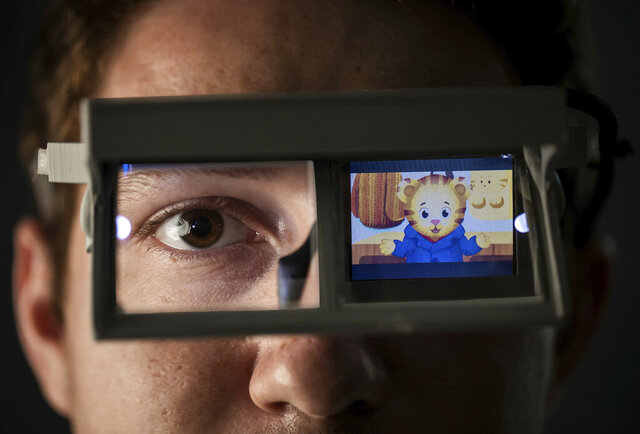 This undated photo provided by Brigham Young University shows glasses designed by a team of Brigham Young University students to help nonverbal children with autism develop eye contact. (Rebekah Baker/Brigham Young University, via AP)
