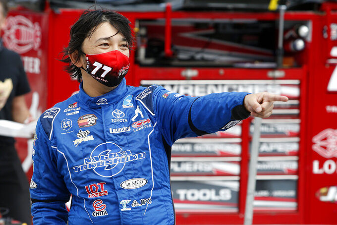 Takuma Koga, of Japan, prior to the ARCA Series auto race at Phoenix Raceway, Saturday, Nov. 7, 2020, in Avondale, Ariz. (AP Photo/Ralph Freso)
