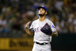 Texas Rangers pitcher Jonathan Hernandez walks off the mound after being removed during the first inning of the team's baseball game against the Oakland Athletics on Saturday, Sept. 21, 2019, in Oakland, Calif. (AP Photo/Ben Margot)