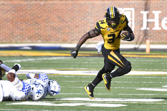 Missouri running back Larry Rountree III, right, runs past Kentucky defenders during the first half of an NCAA college football game Saturday, Oct. 24, 2020, in Columbia, Mo. (AP Photo/L.G. Patterson)