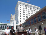 Atlantic City N.J. Mayor Marty Small, center, speaks at a news conference on the city's Boardwalk on Thursday, June 17, 2021 at which he announced that sirens will sound each night at 10 pm to announce the arrival of a curfew for juveniles. (AP Photo/Wayne Parry)