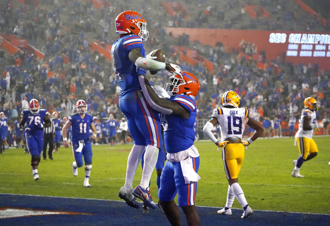 Florida wide receiver Kadarius Toney, left, celebrates his touchdown with tight end Keon Zipperer during the second half of the team's NCAA college football game against LSU, Saturday, Dec. 12, 2020, in Gainesville, Fla. (AP Photo/John Raoux)