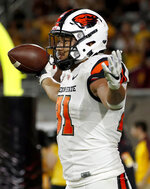 FILE - In this Sept. 29, 2018, file photo, Oregon State tight end Noah Togiai celebrates his touchdown catch against Arizona State during the second half of an NCAA college football game in Tempe, Ariz. The Beavers open at home with a Friday night game against Oklahoma State. (AP Photo/Matt York, File)