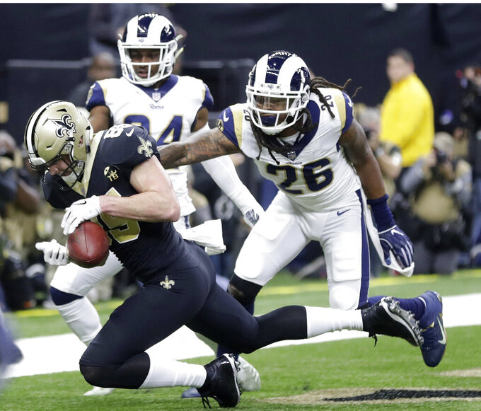 New Orleans Saints' Dan Arnold bobbles a catch in the end zone during the first half of the NFL football NFC championship game against the Los Angeles Rams, Sunday, Jan. 20, 2019, in New Orleans. (AP Photo/Gerald Herbert)