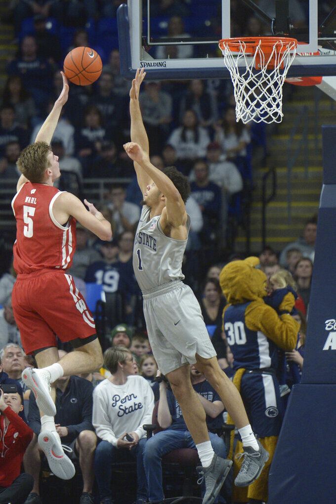 Wisconsin's Tyler Wahl (5) shoots over Penn State's Seth Lundy (1) during first half action of an NCAA college basketball game, Saturday, Jan. 11, 2020, in State College, Pa. (AP Photo/Gary M. Baranec)