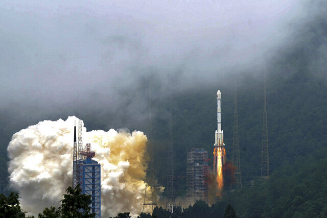 In this photo released by Xinhua News Agency, a rocket carrying the last satellite of the Beidou Navigation Satellite System blasts off from the Xichang Satellite Launch Center in southwest China's Sichuan Province, Tuesday, June 23, 2020. China launched the final satellite in its Beidou constellation that emulates the U.S. Global Positioning System, marking a further step in the country's advance as a major space power. (Xue Chen/Xinhua via AP)