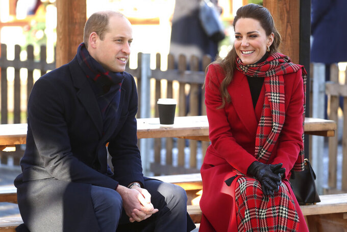 Britain's Prince William and Kate Duchess of Cambridge talk to members of the public at Cardiff Castle on Tuesday Dec. 8, 2020, in Cardiff, Wales.  Prince William and Kate Duchess of Cambridge are undertaking a short tour of the UK by train ahead of the Christmas holidays to pay tribute to the inspiring work in local communities. (Chris Jackson/Pool via AP)