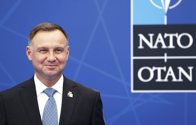 FILE - In this Monday, June 14, 2021 file photo, Poland's President Andrej Duda arrives for a NATO summit at NATO headquarters in Brussels. Poland's President Andrzej Duda said Friday July 30, 2021, he sees the need for changes to his country's law on disciplining judges, in a significant shift in tone on an issue that has brought a tense and drawn-out spat with European Union authorities. (Kenzo Tribouillard/Pool via AP, File)