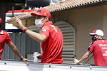 Ferrari driver Charles Leclerc of Monaco waves during the drivers parade prior to the Monaco Grand Prix at the Monaco racetrack, in Monaco, Sunday, May 23, 2021. (AP Photo/Luca Bruno)