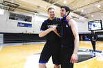 Yeshiva forward Kevin Bokor, left, celebrates a win over Worcester Polytechnic Institute with guard Max Leibowitz, right, after an NCAA DIII college basketball game that allowed no spectators on Friday, March 6, 2020, in Baltimore, Md. The game at Johns Hopkins University is believed to be the first U.S. sports event held without fans because of the new coronavirus. (AP Photo/Terrance Williams)