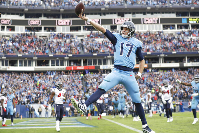 Tennessee Titans quarterback Ryan Tannehill (17) scores a touchdown on a 1-yard run against the Houston Texans in the second half of an NFL football game Sunday, Dec. 15, 2019, in Nashville, Tenn. (AP Photo/James Kenney)